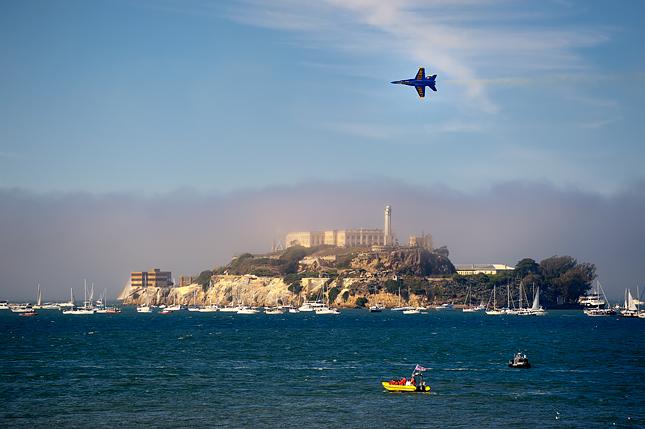 Blue Angel flies by Alcatraz Island